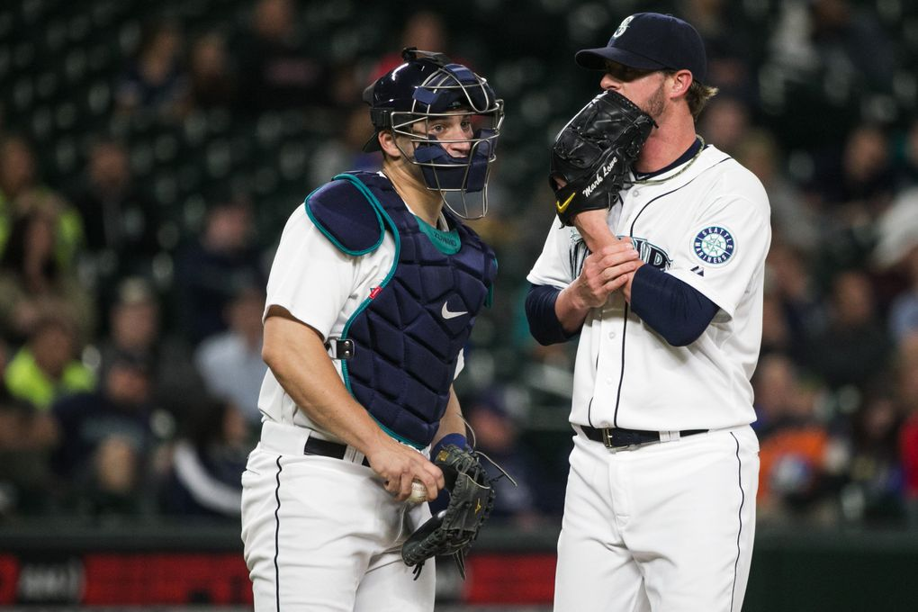Closer Mark Lowe talks with catcher Mike Zunino after giving up a double to Evan Longoria as the Seattle Mariners take on the Tampa Bay Rays at Safeco Field in Seatt le Thursday June 4, 2015. (Bettina Hansen / The Seattle Times)