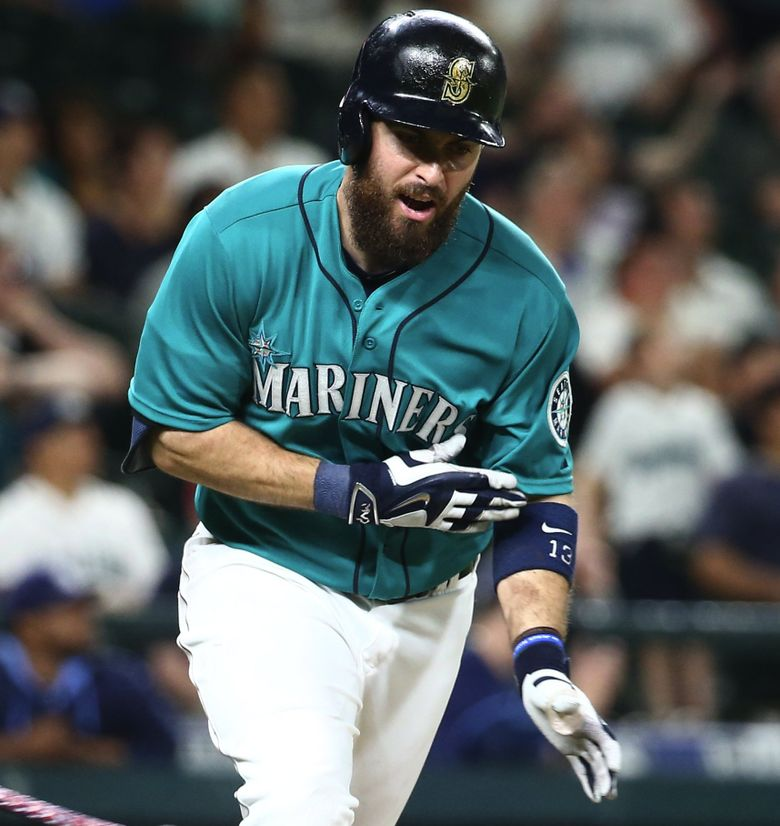 Mariners center fielder Dustin Ackley throws his bat to the ground as he flies out to end the game, leaving Austin Jackson on third base in the second game of a four-game series against the Tampa Bay Rays at Safeco Field on Friday, June 5, 2015. The Mariners were handed their seventh loss in a row by the Rays, losing 1-0.  (Lindsey Wasson/The Seattle Times)