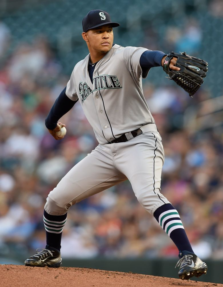 Mariners pitcher Taijuan Walker delivers during the first inning against the Minnesota Twins. (Hannah Foslien/Getty Images)