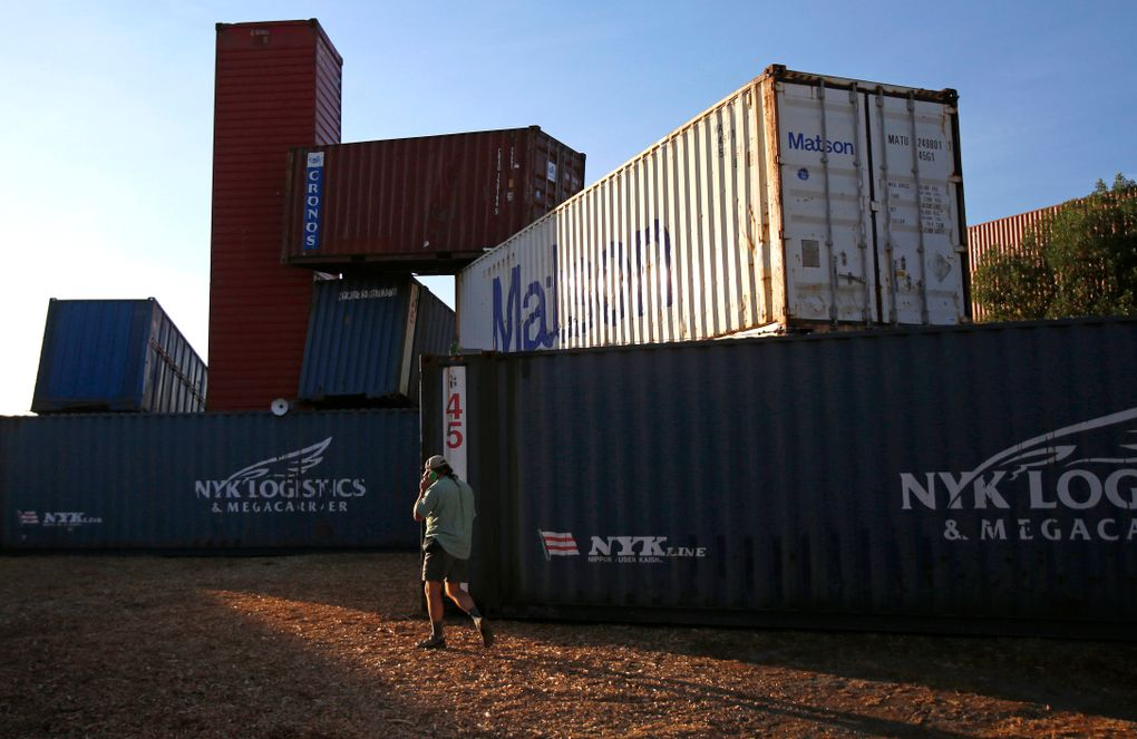 """Designed by Christian French and Equinox Special Projects Division, """"Estuary"""" is an art installation made out of shipping containers that also acts as a gathering place and a stage. (Sy Bean/The Seattle Times)"""