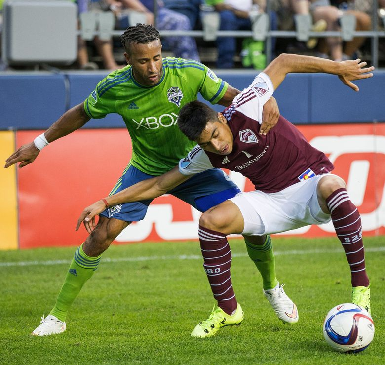 Seattle defender Tyrone Mears tries to get around the Colorado Rapids' Juan Ramirez in a July 18 match at CenturyLink Field. The Sounders lost to the Rapids, 1-0. (Dean Rutz/The Seattle Times)