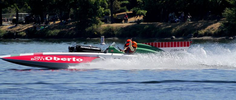 Art Oberto, 88, owner of the vintage Oh Boy! Oberto, waves during his first-ever ride in a hydroplane. (Greg Gilbert/The Seattle Times)