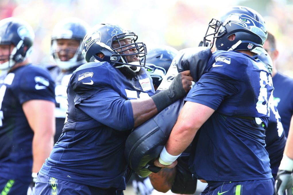 Seahawks tackle Alvin Bailey, left, runs a drill with teammate Drew Nowak at training camp on Thursday. (John Lok / The Seattle Times)