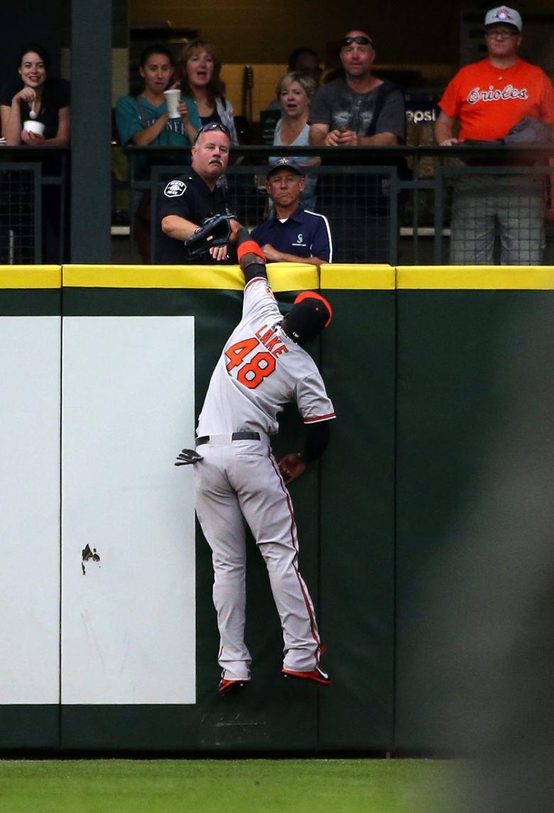 Orioles left fielder Junior Lake tries in vain to catch homer by Mariners left fielder Franklin Gutierrez in the second inning. (Ken Lambert / The Seattle Times)