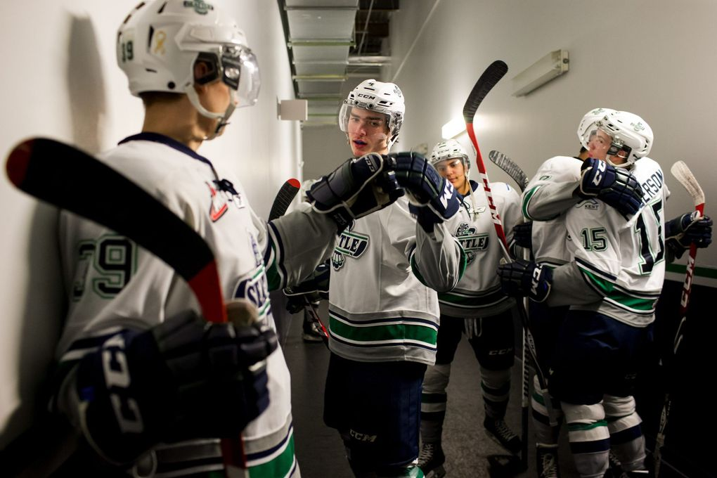 In this February 2015 file photo, Seattle Thunderbirds Nick Holowko, left, and Turner Ottenbreit, both 17, high-five before playing The Calgary Hitmen in Kent. The Western Hockey League, which the Thunderbirds play in, was under investigation by the state Department of Labor and Industries for possible child-labor violations, but the investigation was closed without making a decision. (ERIKA SCHULTZ / THE SEATTLE TIMES)