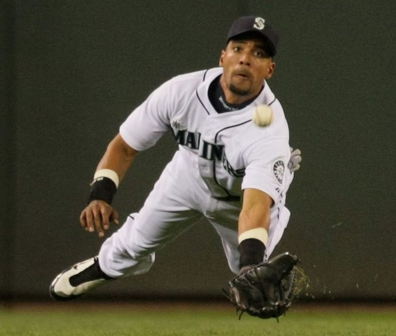 Franklin Gutierrez is unable to catch up to this bloop fly that scores New York's first run in the top of the second inning of the game with the Yankees at Safeco Field, Thursday August 13, 2009.  (JIM BATES / The Seattle Times)