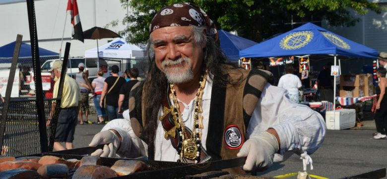 The salmon bake is a popular draw at Lake City SalmonFest, which runs Friday-Sunday, Aug. 7-9. Another highlight, the Pioneer Days Parade, happens Saturday.