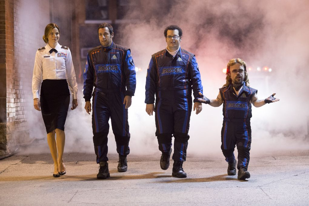 """From left, Michelle Monaghan, Adam Sandler, Josh Gad and Peter Dinklage star in """"Pixels,"""" a film that pits a bunch of dorky losers against real-life video-game characters.  (George Kraychyk/AP)"""