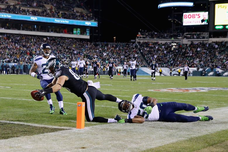 Zach Ertz #86 of the Philadelphia Eagles scores a touchdown against K.J. Wright #50 of the Seattle Seahawks during the third quarter of the game at Lincoln Financial Field on December 7, 2014 in Philadelphia, Pennsylvania. (Photo by Elsa/Getty Images)