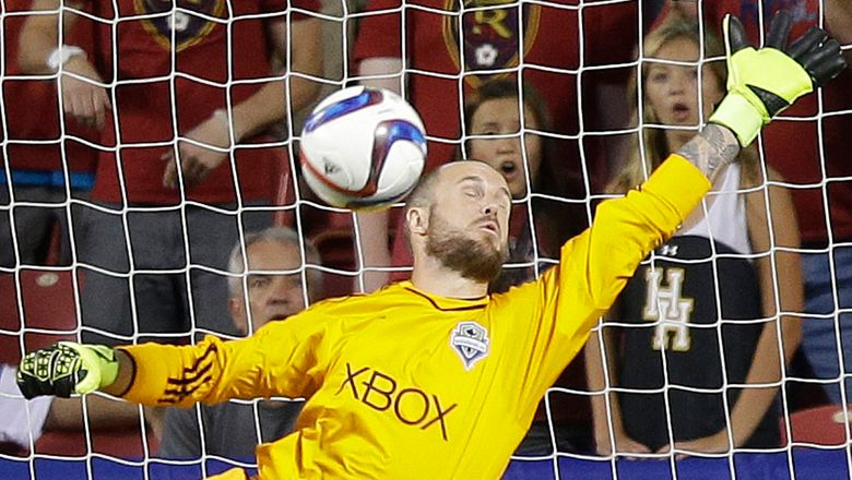 Sounders' goalkeeper Stefan Frei makes a save against Real Salt Lake during the first half. (Rick Bowmer/AP)