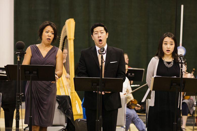 "From left, Nina Yoshida Nelsen, mezzo-soprano, Adam Lau, bass, and Hae Ji Chang, soprano, sing in a workshop last summer for ""An American Dream,"" Seattle Opera's world-premiere coming to McCaw Hall Aug. 21-22.  (""Brandon Patoc"")"