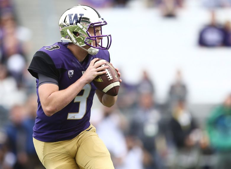 Washington quarterback Jake Browning prepares to throw a pass in the first quarter against Utah State last week at Husky Stadium. (Lindsey Wasson/The Seattle Times)
