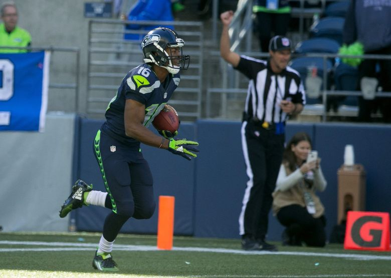 Seahawks wide receiver Tyler Lockett returns the third-quarter kickoff 105 yards for a touchdown against the Bears on Sunday at CenturyLink Field. (Bettina Hansen / The Seattle Times)