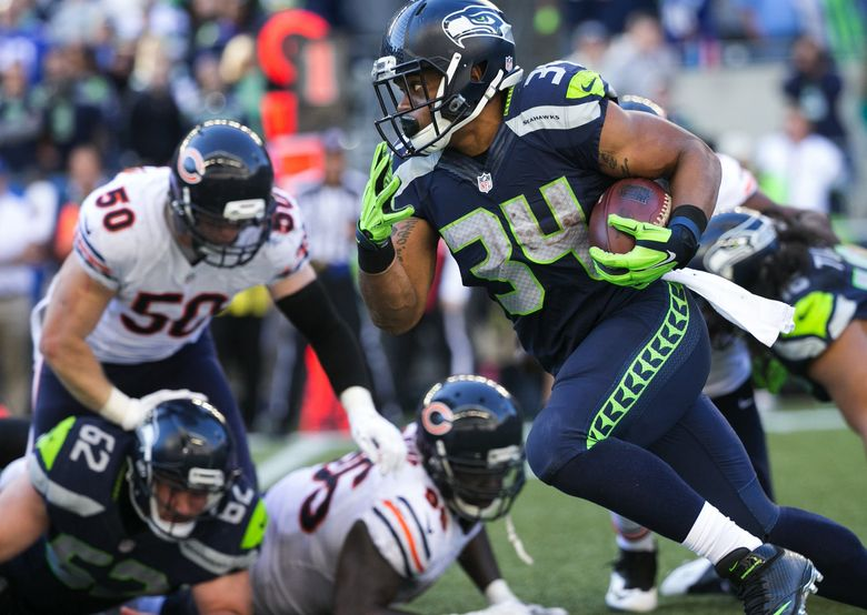 Rookie running back Thomas Rawls (34) provides some rushing power to the Seahawks, gaining 104 yards on 16 carries as Marshawn Lynch was sidelined with injuries. (Bettina Hansen/The Seattle Times)