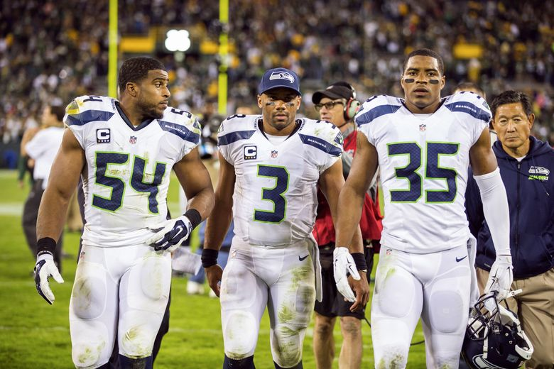 Seahawks players, from left, Bobby Wagner, Russell Wilson and DeShawn Shead head for the locker room at Lambeau Field after the 27-17 loss to the Green Bay Packers. Shead started at strong safety in place of holdout Kam Chancellor. (Dean Rutz / The Seattle Times)