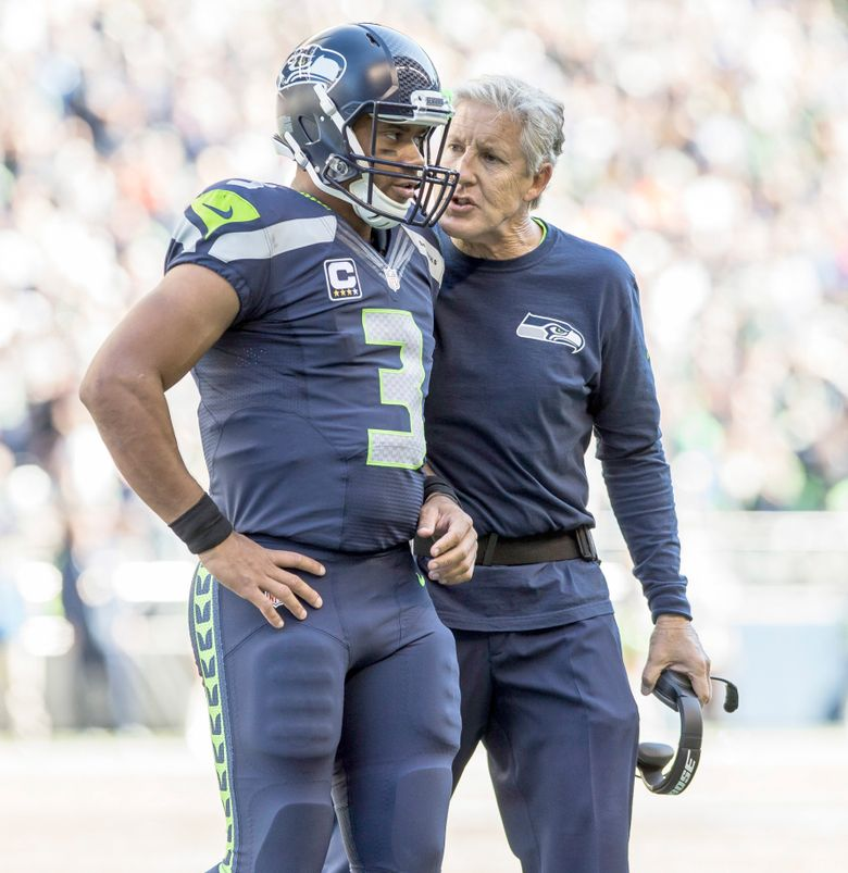 Seahawks coach Pete Carroll and quarterback Russell Wilson talk over what would be the offense's last possession of the first half.