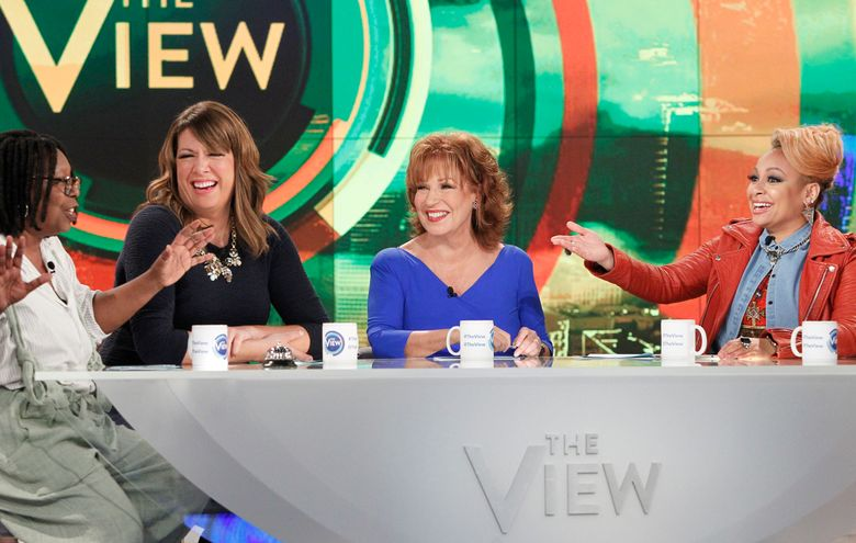 """In this Sept. 9, 2015 photo released by ABC, co-hosts, from left, Whoopi Goldberg, Michelle Collins, Joy Behar and Raven-Symone appear on the daytime talk show, """"The View,"""" in New York.  Behar, who """"retired"""" with great fanfare two years ago, said she was intrigued about coming back heading into an election year. Behar won't be on every day, but will be the moderator on Fridays. (Lou Rocco/ABC via AP)"""