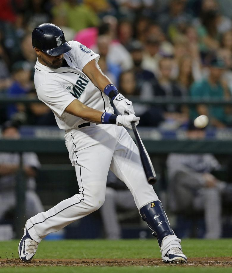 Franklin Gutierrez hits a homer against the Colorado Rockies. An arthritic disease limits his playing time, but he's looking ahead. (Ted S. Warren/The Associated Press)