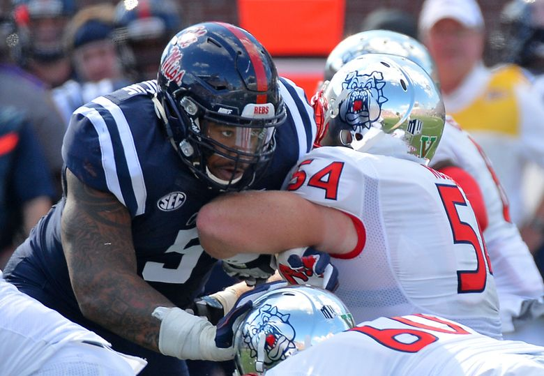 FILE – In this Sept. 12, 2015, file photo, Mississippi defensive tackle Robert Nkemdiche (5) fights past Fresno State offensive lineman Justin Northern (54) during the first half of an NCAA college football game in Oxford, Miss. Whether it was Zen or just the brute force of his body crashing through the Alabama offensive line, Nkemdiche had the best game of his college career in the Rebels' stunning 43-37 victory over the Crimson Tide last Saturday. (AP Photo/Thomas Graning, File)