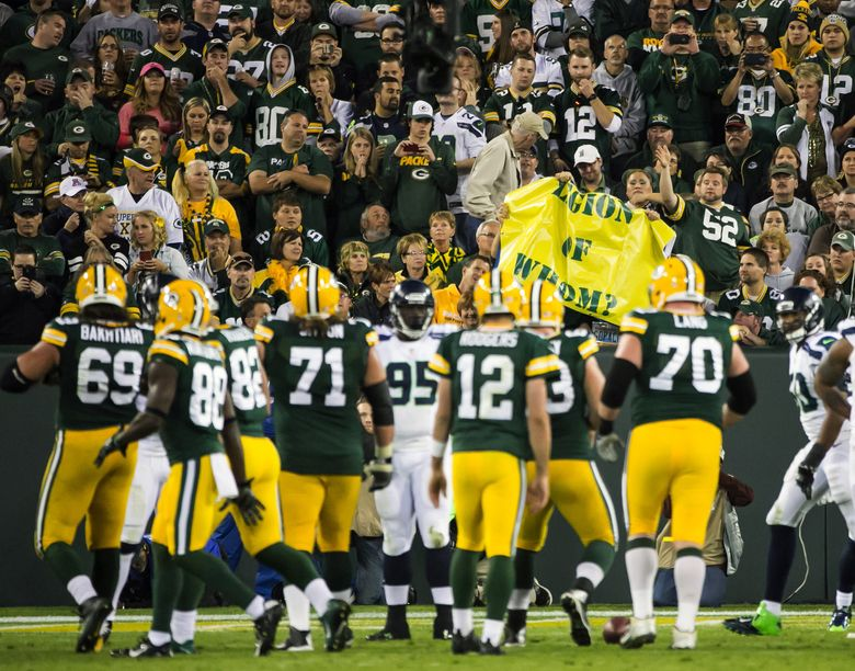 """Packers fans taunt the Seahawks defense in the fourth quarter with a """"Legion of Whom?"""" sign at Lambeau Field. (Bettina Hansen/The Seattle Times)"""