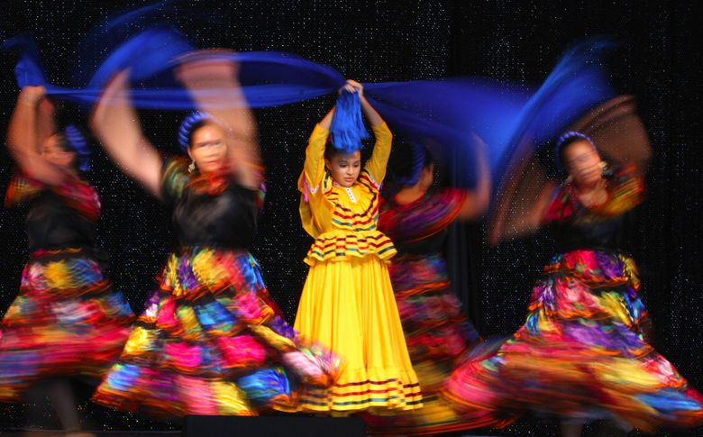 Natalie Guerrero, 15, center, takes part in the Rascapetate dance with the rest of the Guelaguetza Mexican folk dance group during Fiestas Patrias on Sunday at Seattle Center. The dance, from the Chiapas area of Mexico, is performed at celebrations.  (John Lok / The Seattle Times)