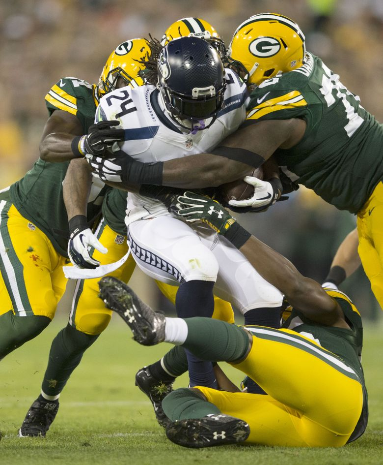 Seahawks running back Marshawn Lynch gets wrapped up by several members of the Packers defense. Lynch had just 41 yards on 15 carries. (Dean Rutz / The Seattle Times)