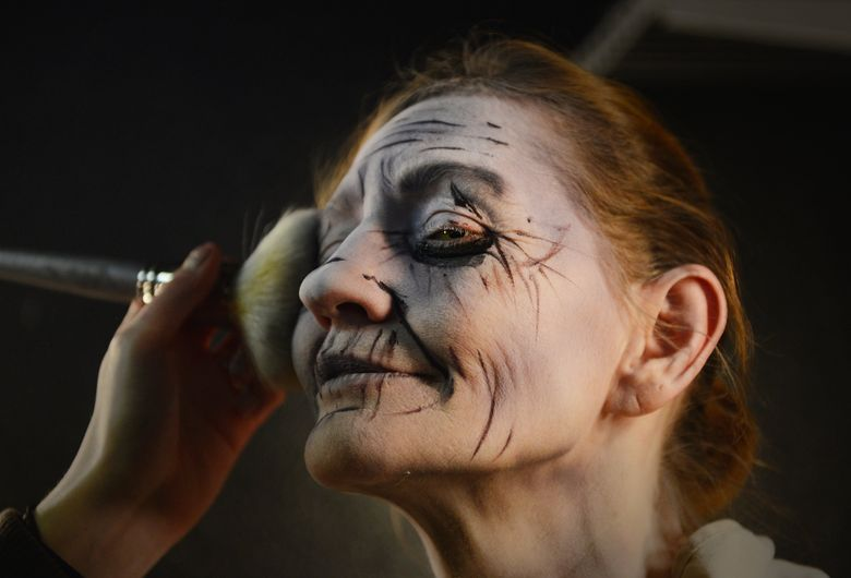 Cheri Malena, in her first year of scaring, gets her makeup finished in preparation for her job at the KUBE 93 Haunted House at the Georgetown Morgue, in Seattle. The attraction runs this year until Nov. 1.  (LINDSEY WASSON/The Seattle Times)