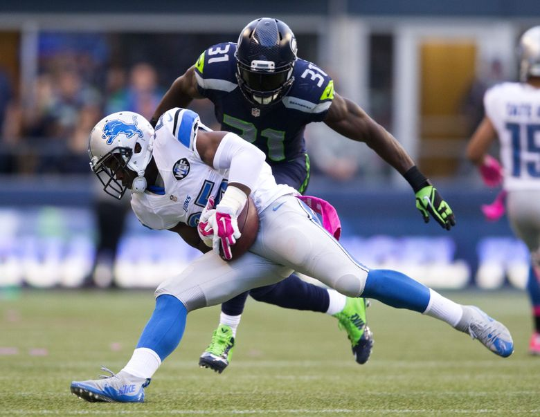 Seahawks safety Kam Chancellor closes in on Lions running back Theo Riddick in the first quarter Monday at CenturyLink Field. (Dean Rutz / The Seattle Times)