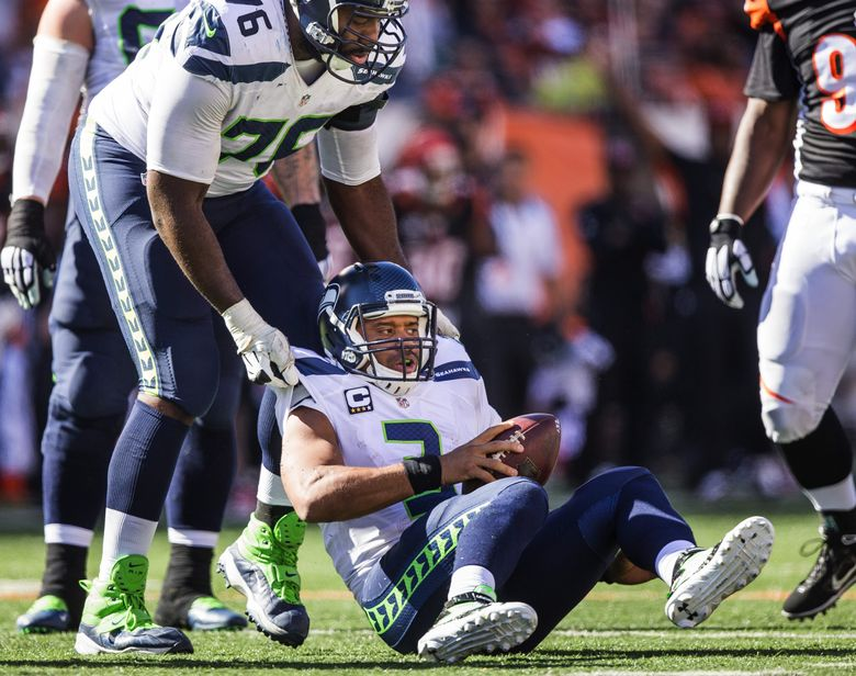 Russell Okung, left, visited the Steelers on Sunday and is now said to be considering his options after earlier visiting the Giants and Lions. Okung could also still re-sign with Seattle. (Dean Rutz / The Seattle Times)