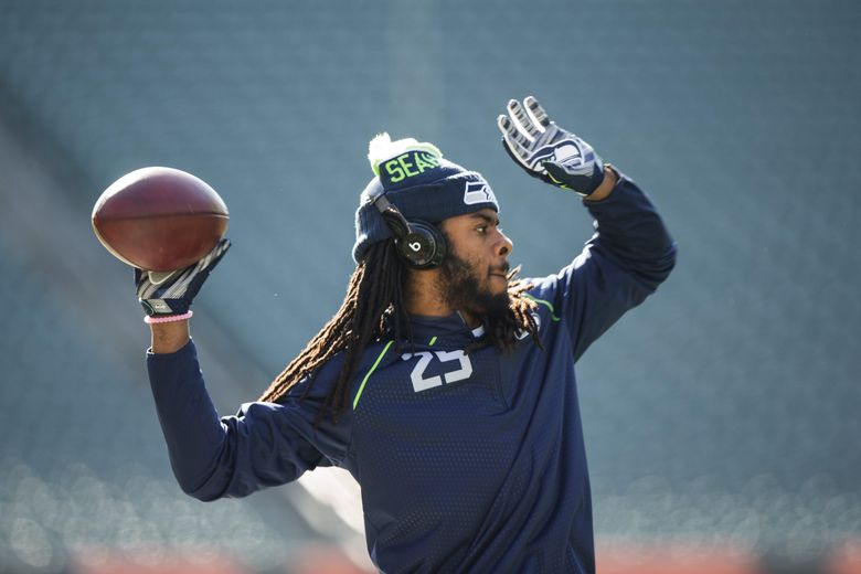 Seahawks cornerback Richard Sherman warms up before a game against the Bengals on Oct. 11, 2015, in Cincinnati. (Dean Rutz / The Seattle Times)