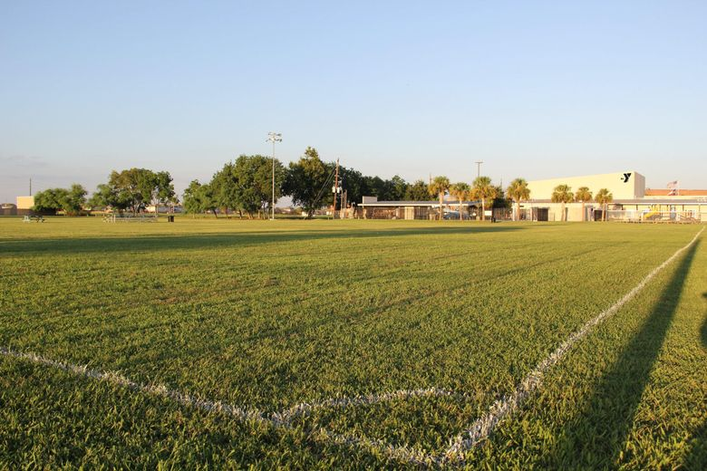 Russell Okung's first football field at the Alief YMCA football field photography .
