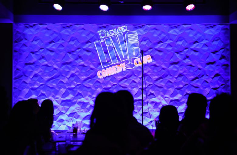 The Parlor Live logo flashed onto the screen as a show started at the Parlor Live Comedy Club's Seattle location in 2014. The club abruptly closed Sunday. (Lindsey Wasson / The Seattle Times, 2014)