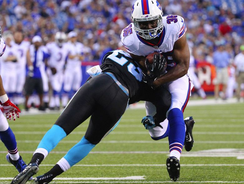 Former Buffalo Bills running back Bryce Brown, who re-signed with Seattle this week, runs against Carolina Panthers cornerback Melvin White during a preseason game Aug. 14, 2015, in Orchard Park, N.Y. (Bill Wippert / AP)