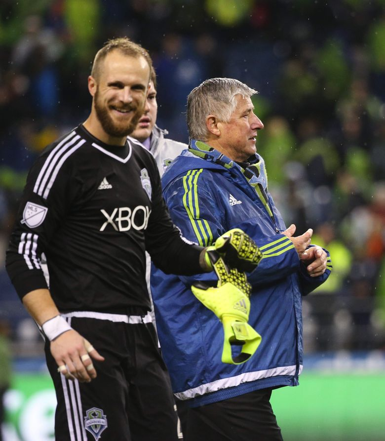 Sounders coach Sigi Schmid walks with Sounders goalkeeper Stefan Frei after the Sounders beat the L.A. Galaxy in the Western Conference Knockout Round at CenturyLink Field in Seattle.   (Lindsey Wasson / The Seattle Times)