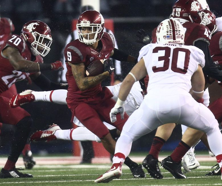 Washington State wide receiver Gabe Marks (9) gains 20 yards on a return in the 2nd quarter of the game against Stanford in Pullman on Saturday.   (Lindsey Wasson / The Seattle Times)
