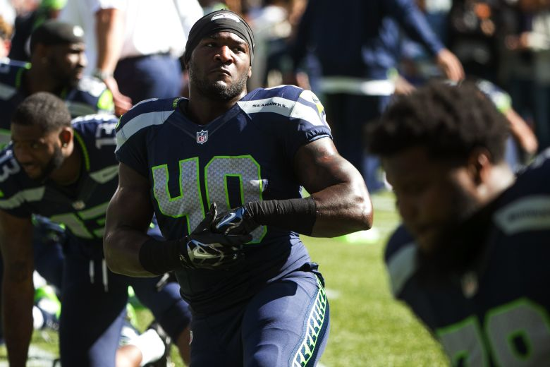 Seahawks fullback Derrick Coleman stretches with the team before the Seattle Seahawks take on the Chicago Bears for their home opener at CenturyLink Field in Seattle Sunday September 27, 2015.