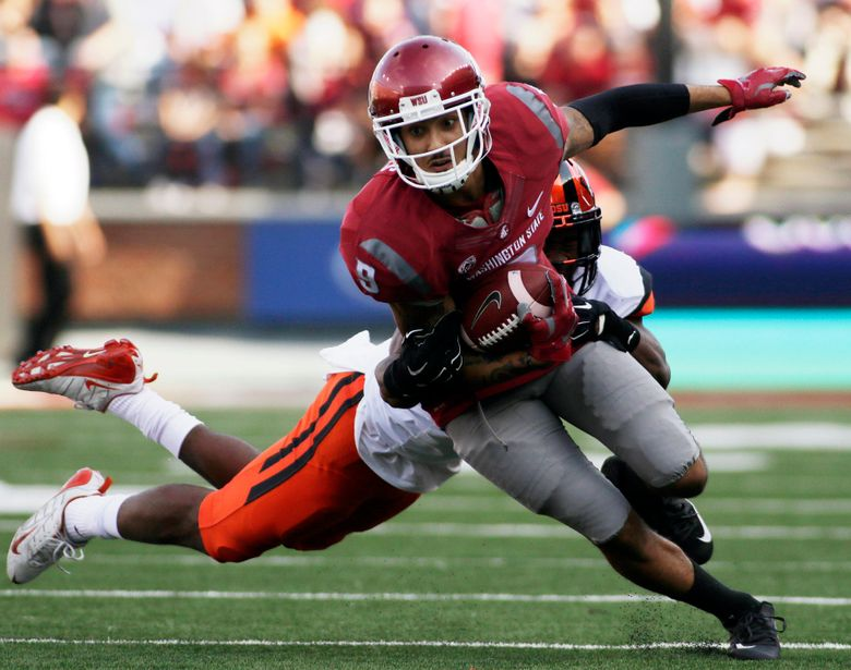 Washington State wide receiver Gabe Marks (9) breaks a tackle by Oregon State safety Cyril Noland-Lewis during the first half of an NCAA college football game, Saturday, Oct. 17, 2015, in Pullman, Wash. (AP Photo/Young Kwak) — WAYK102 (Young Kwak/AP)