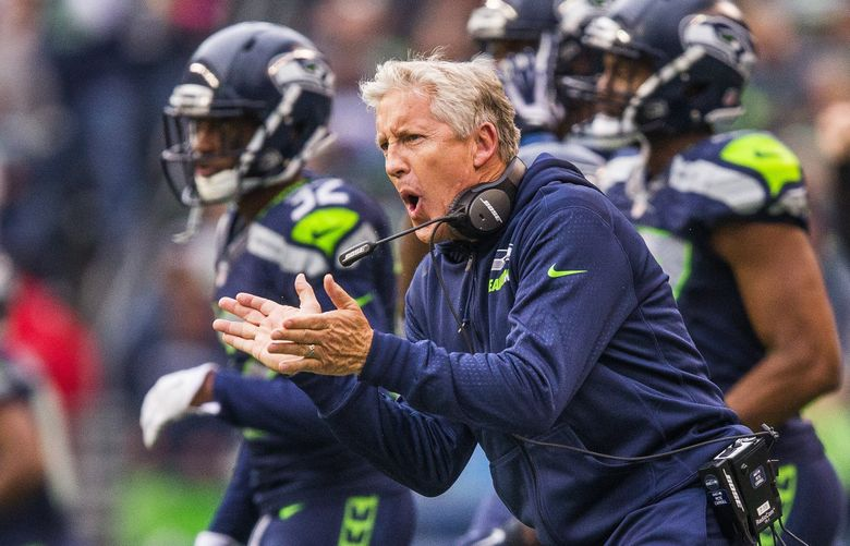 Seattle head coach Pete Carroll pumps up his defense early in the fourth quarter Sunday at CenturyLink Field, before the Panthers came from behind to snag a 27-23 victory over the struggling Seahawks. (Dean Rutz / The Seattle Times)