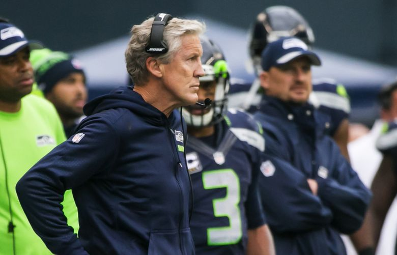 Seahawks head coach Pete Carroll looks stone-faced as he watches the PAT on the Panthers' game-winning touchdown in the final 30 seconds of Sunday's 27-23 Seahawks loss at CenturyLink Field. (Bettina Hansen / The Seattle Times)
