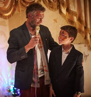 """Vincent Cassel, center, plays a commune leader who teaches children (pictured, Jeremy Chabriel) how to garden and how to kill in """"Partisan."""""""