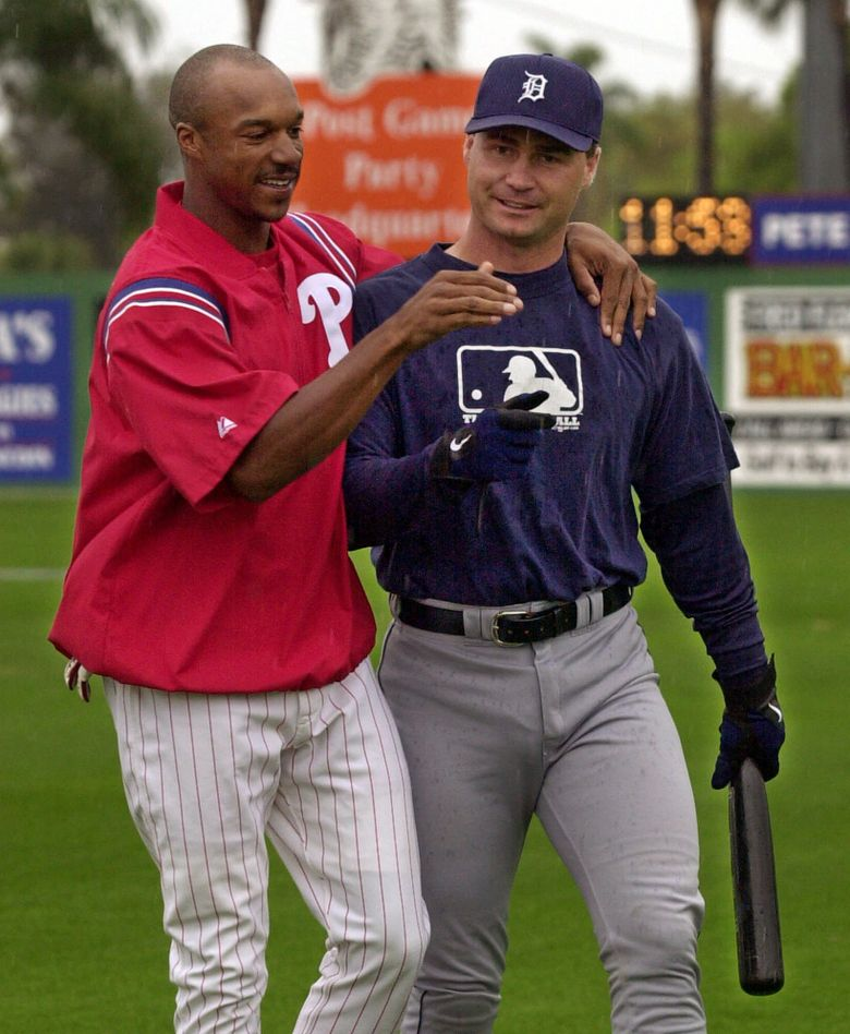 Scott Servais, right, as a Detroit Tigers catcher with Phillies outfielder Brian L. Hunter in 2001.  (KATHY WILLENS/AP)