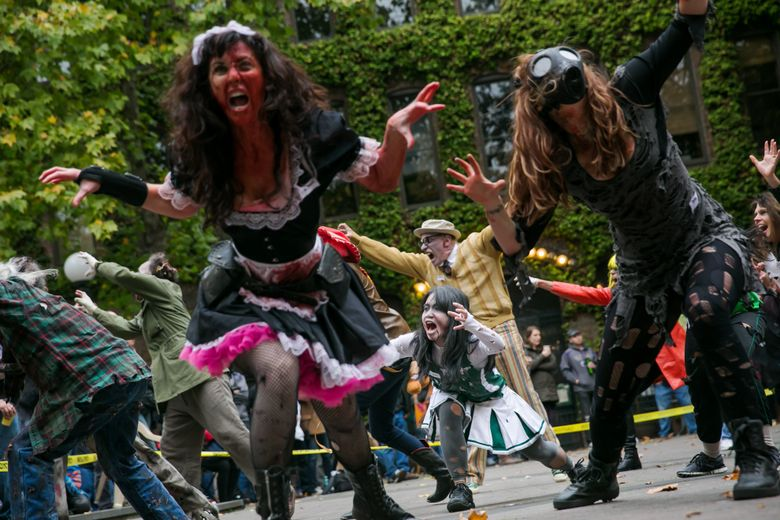 """More than 100 people performed at the """"Thrill The World"""" event at Occidental Park in Seattle in 2013. (Marcus Yam / The Seattle Times)"""