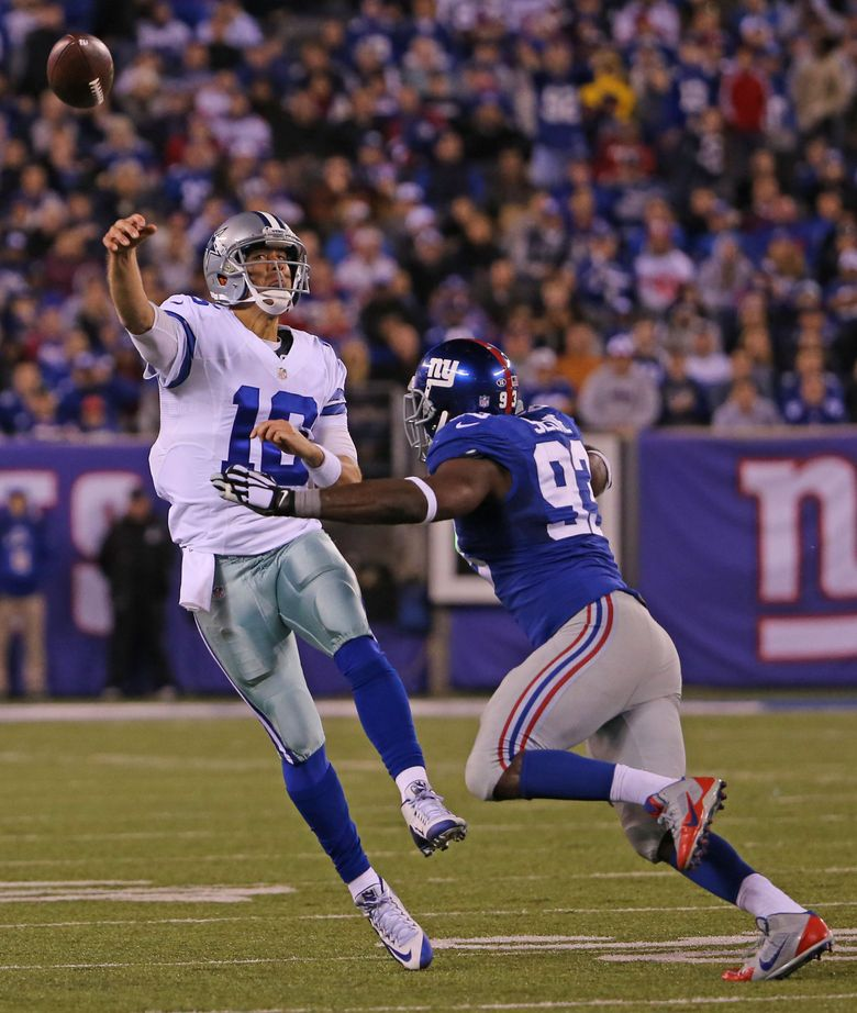 Under pressure, Dallas Cowboys quarterback Matt Cassel (16) heaves the ball for a touchdown during the fourth quarter on Sunday, Oct. 25, 2015, at MetLife Stadium in East Rutherford, N.J. (Paul Moseley/TNS)