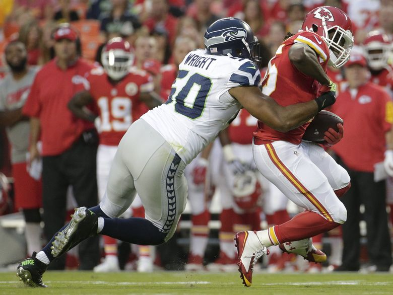Kansas City Chiefs running back Jamaal Charles is tackled for a loss by Seahawks linebacker K.J. Wright in a preseason game on Aug. 21.  (Charlie Riedel/AP)