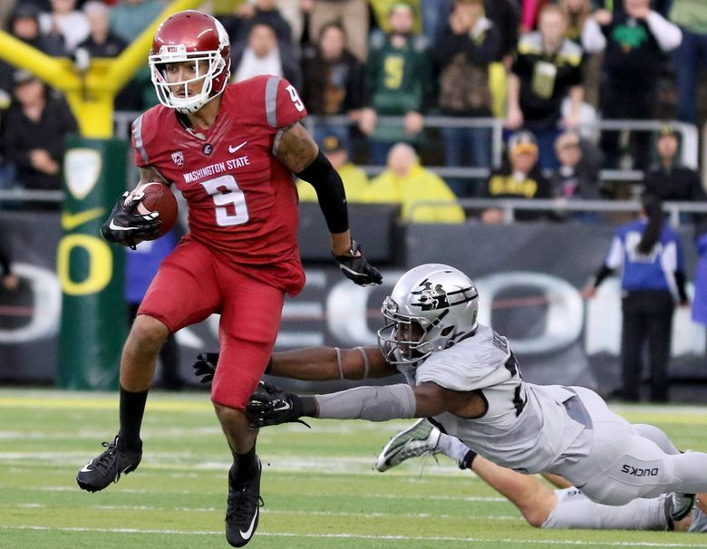 WSU wide receiver Gabe Marks avoids a tackle during the Cougars'  45-38 win over the Oregon Ducks on Saturday.  (AP Photo/Ryan Kang)