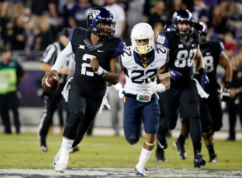 TCU quarterback Trevone Boykin (2) scrambles out of the pocket and keeps the ball on a long run from the line of scrimmage as West Virginia safety Jarrod Harper (22) gives chase in the second half of an NCAA college football game Thursday, Oct. 29, 2015, in Fort Worth, Texas. Boykin leaped over defenders and threw from the hip for touchdowns, breaking TCU's career record for total offense while leading the fifth-ranked Horned Frogs past West Virginia 40-10 on Thursday night for their 16th consecutive victory. (AP Photo/Tony Gutierrez)