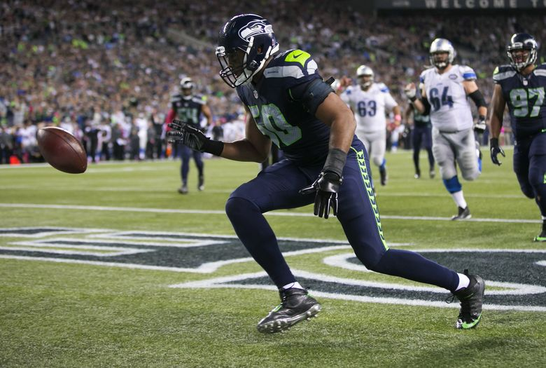 Seahawks linebacker K.J. Wright smacks the ball from the end zone after Seahawks safety Kam Chancellor caused a touchback during the fourth quarter as the Seattle Seahawks take on the Detroit Lions at CenturyLink Field in Seattle Monday, October 5, 2015. (Bettina Hansen/The Seattle Times)