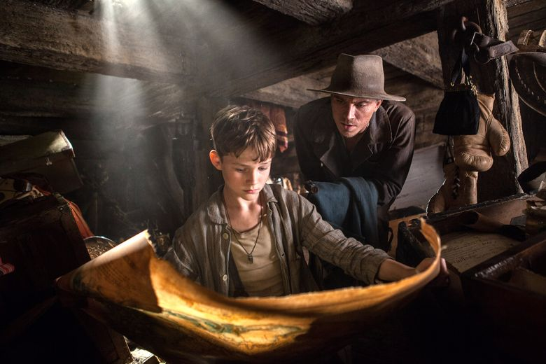 """Newcomer Levi Miller, left, plays the orphan Peter and Garrett Hedlund a stylish Hook in an over-the-top """"Pan."""" (Laurie Sparham)"""