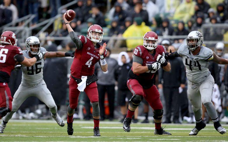 Washington State quarterback Luke Falk (4) passes during the second half of an NCAA college football game against Oregon, Saturday, Oct. 10, 2015, in Eugene, Ore. Washington State won 45-38. (AP Photo/Ryan Kang)