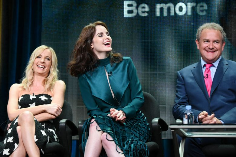 """FILE – In this Aug. 1, 2015 file photo, actors Joanne Froggatt, from left, Michelle Dockery, and Hugh Bonneville speak onstage during the """"Downton Abbey"""" panel at the PBS 2015 Summer TCA Tour held at the Beverly Hilton Hotel, in Beverly Hills, Calif. The final season of the popular British drama """"Downton Abbey"""" will begin on Jan. 3, 2016, leading up to a finale on the first weekend of March, PBS announced Monday, Oct. 19, 2015. The show has been both a creative and ratings triumph for the network. (Photo by Richard Shotwell/Invision/AP, File)"""